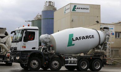 The logo of French building material Lafarge is seen on cement trucks at a production plant in Paris, France, February 22, 2016. In July 2015, Lafarge and Holcim have become one to create a new leader in building materials. REUTERS/Jacky Naegelen - RTX282G4